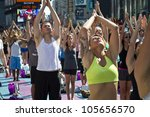 NEW YORK - JUNE 20: A heat wave in Manhattan on the first Day of Summer didn't stop the Yoga exercises in Times Square on June 20, 2012. - stock photo