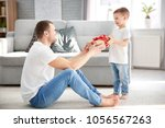 man receiving gift for father's ... | Shutterstock . vector #1056567263