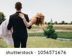 shot of behind of bridegroom... | Shutterstock . vector #1056571676