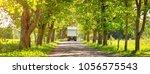 lorry on asphalt road on spring ... | Shutterstock . vector #1056575543