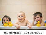 little baby boy  playing with... | Shutterstock . vector #1056578033