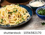 spaghetti carbonara with egg... | Shutterstock . vector #1056582170