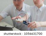 a boy teenager with a teacher... | Shutterstock . vector #1056631700