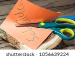Small photo of indebtedness cutting with scissors