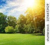 summer sun illuminates park... | Shutterstock . vector #1056653429