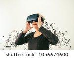 an elderly woman in virtual... | Shutterstock . vector #1056674600