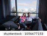 young couple relaxing at  home... | Shutterstock . vector #1056677153