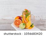 citrus fruit and herbs water... | Shutterstock . vector #1056683420