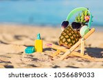 ripe attractive girl pineapple... | Shutterstock . vector #1056689033