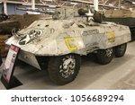 Small photo of BOVINGTON, DORSET, UK - JULY 7, 2012: American M8 Greyhound Armoured Car on display at the Bovington Tank Museum in Dorset.