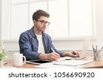 young concentrated man typing...   Shutterstock . vector #1056690920