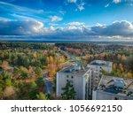 over the suburbs | Shutterstock . vector #1056692150
