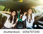 three girls driving in a car... | Shutterstock . vector #1056707240