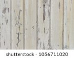 wooden planks  paint coming off ... | Shutterstock . vector #1056711020