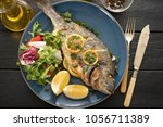 grilled dorado with lemon ... | Shutterstock . vector #1056711389