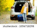 adorable girl with a suitcase... | Shutterstock . vector #1056718298