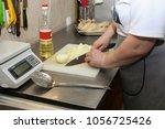 female hands cutting bulb onion ... | Shutterstock . vector #1056725426