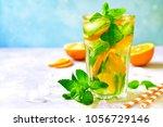 homemade orange lemonade with... | Shutterstock . vector #1056729146