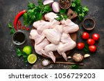 raw chicken wings with... | Shutterstock . vector #1056729203