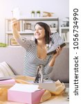 fashion blogger at home taking...   Shutterstock . vector #1056734990