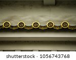 Small photo of Detail of ornamentation on the roof of the famous Osaka Castle, Japan