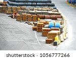 stacked rusty rolled metal ... | Shutterstock . vector #1056777266