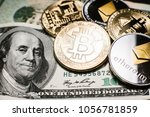 Bitcoin (BTC) and Ethereum (ETH) cryptocurrency (crypto currency) are digital money with decentralized ledger. Gold bitcoin and silver ethereum coins closeup over the one hundred dollar bill