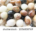 background of onyx stone eggs... | Shutterstock . vector #1056838769