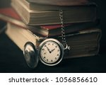 three old book and clock close... | Shutterstock . vector #1056856610
