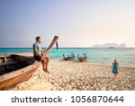 man on the long tail boat and... | Shutterstock . vector #1056870644
