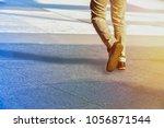 people walking in the street    Shutterstock . vector #1056871544