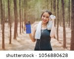 beautiful asian woman drinking...   Shutterstock . vector #1056880628