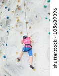 A Female Teenager Climbing A...
