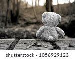Rear View Teddy Bear Sitting On ...
