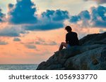 woman silhouette at sunset.... | Shutterstock . vector #1056933770