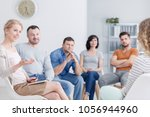 therapist congratulating young... | Shutterstock . vector #1056944960