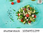 salad of fresh vegetables  ... | Shutterstock . vector #1056951299