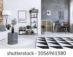 plant on metal table in open... | Shutterstock . vector #1056961580
