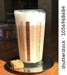 Small photo of Latte machiato on the table with sunshine ,glass cup of coffee latte machiato in restau rant