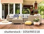 beige garden furniture with...