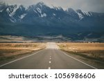 beautiful mountain autumn road. ...   Shutterstock . vector #1056986606