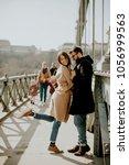 loving couple on chain bridge ... | Shutterstock . vector #1056999563