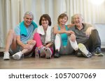 group of senior people sitting... | Shutterstock . vector #1057007069