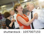 senior people attending dance... | Shutterstock . vector #1057007153