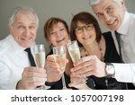 group of senior people cheering ...   Shutterstock . vector #1057007198