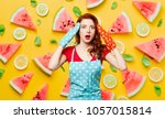 redhead girl with oven gloves... | Shutterstock . vector #1057015814
