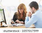 middle aged consultant...   Shutterstock . vector #1057017599