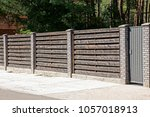Gray Fence In Front Of The Road ...