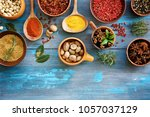 spices bright blue wooden... | Shutterstock . vector #1057037129