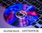 dvd disc isolated on computer... | Shutterstock . vector #1057045928